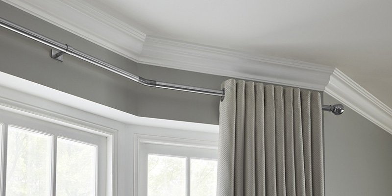 How to Fit a Bay Window Curtain Pole